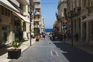 Heraklion, Greece, April 2018. Streets of Heraklion, Greece. Warm, sunny day in a Greek city. Walk around the city on a summer day with a view of the sea. Souvenir shops and gifts for tourists and travelers.