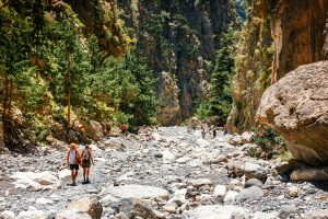 Chania, Crete, Greece, May 26, 2016: Tourists hike in Samaria Gorge in central Crete, Greece. The national park is a UNESCO Biosphere Reserve since 1981